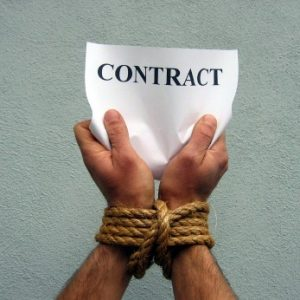 man bound by a contract and rope