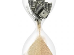 Money turning into sand in hourglass