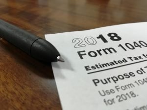 a tax form with a pen