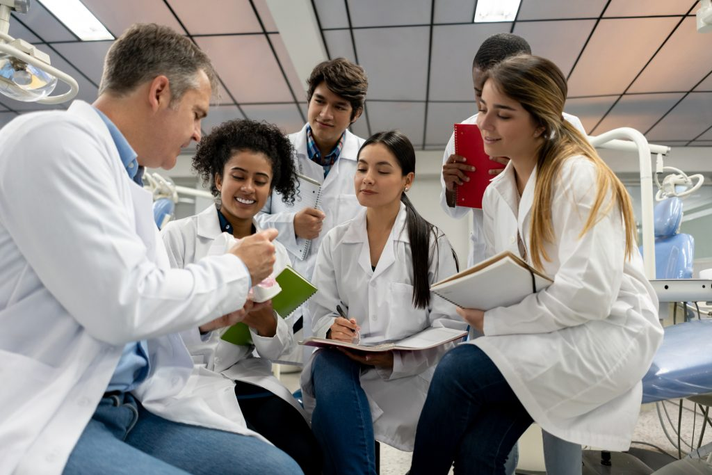 Dental Students being taught in a class or lab