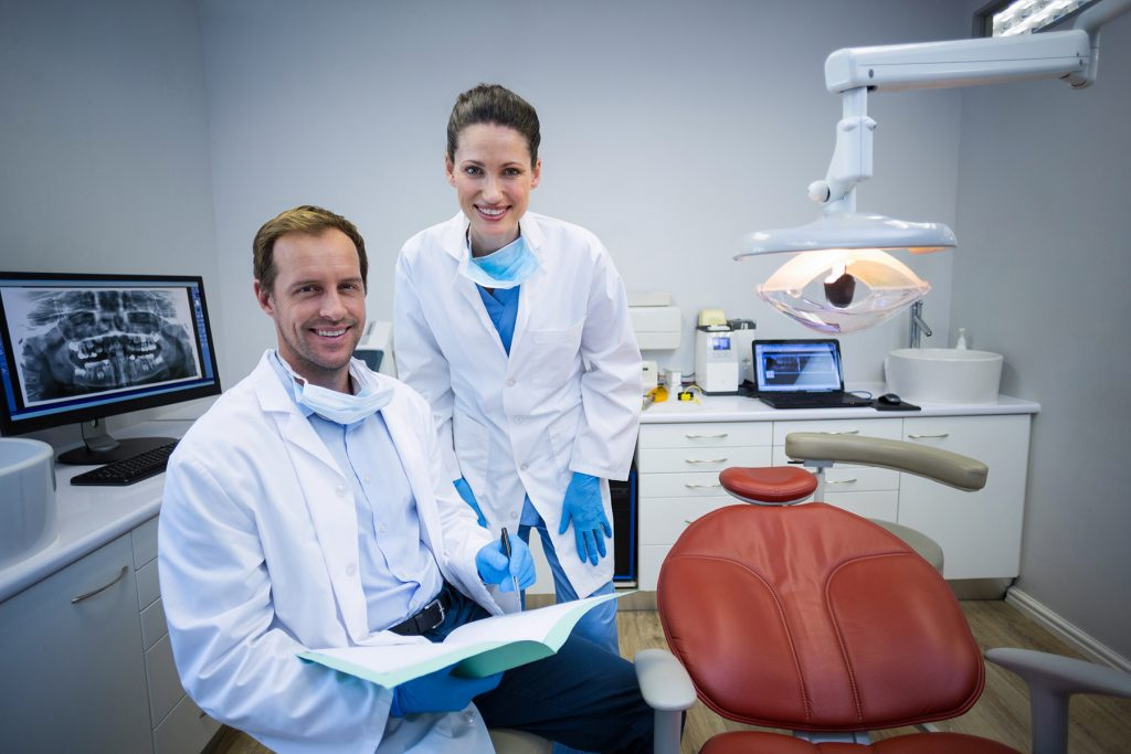 Two practicing dentists in an exam room