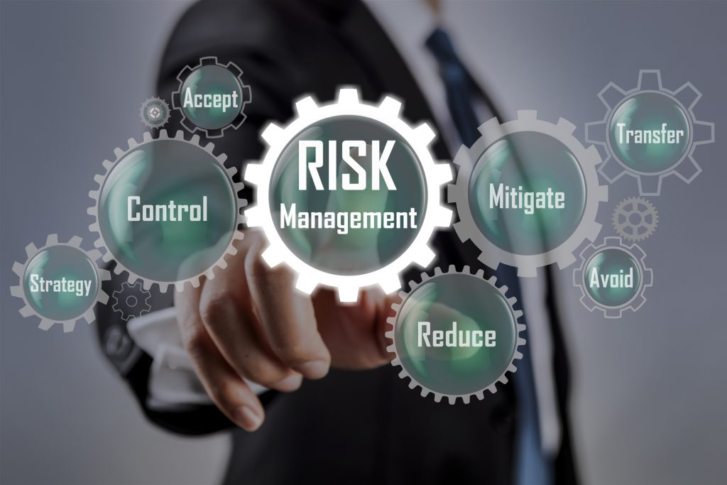Business man selecting Risk management concept on scren