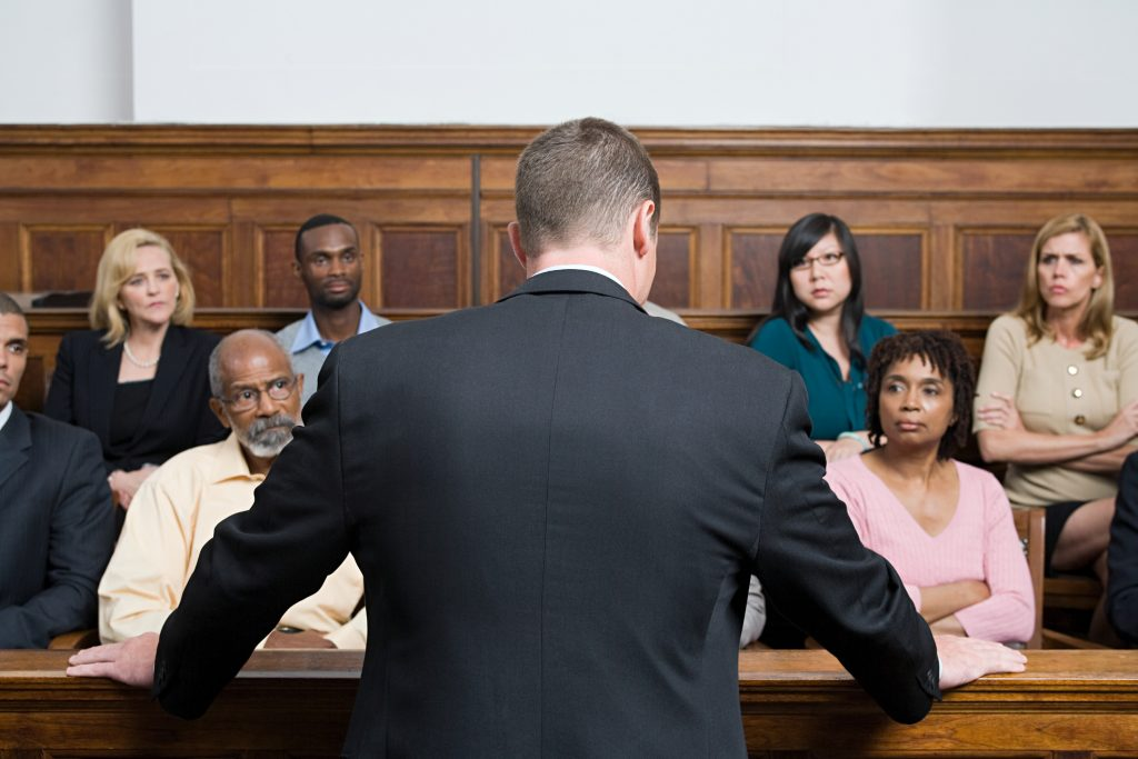 A lawyer speaking in front of a jury